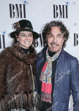 Stock Photo of John Oates, right, and his wife, Aimee, arrive at 67th Annual BMI Country Awards ceremony at BMI Music Row offices, in Nashville, Tenn