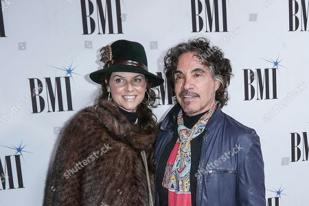 John Oates, right, and his wife, Aimee, arrive at 67th Annual BMI Country Awards ceremony at BMI Music Row offices, in Nashville, Tenn