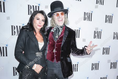 Big Kenny, Christiev Carothers. Big Kenny, right, and his wife, Christiev Carothers, arrive at 67th Annual BMI Country Awards ceremony at BMI Music Row offices, in Nashville, Tenn