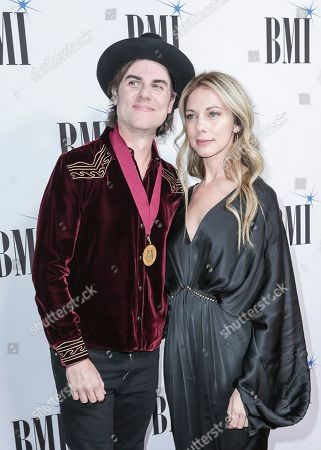Ross Copperman, left, and his wife, Katlin, arrive at 67th Annual BMI Country Awards ceremony at BMI Music Row offices, in Nashville, Tenn