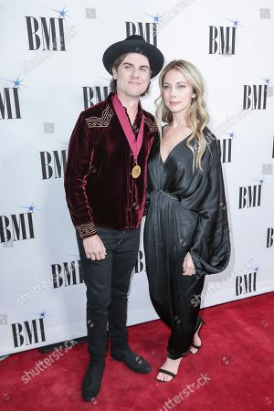 Stock Photo of Ross Copperman, left, and his wife, Katlin, arrive at 67th Annual BMI Country Awards ceremony at BMI Music Row offices, in Nashville, Tenn
