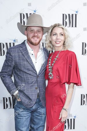 Cody Johnson, left, and his wife, Brandi, arrive at 67th Annual BMI Country Awards ceremony at BMI Music Row offices, in Nashville, Tenn
