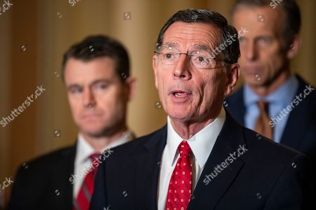 Senator John Barrasso (R-WY) makes a statement after the Republican Party luncheon on Capitol Hill in Washington, DC, USA, 13 November 2019. Republicans ridiculed House Majority Leader Nancy Pelosi and other Democrats in the House of Representatives for their pursuit of the impeachment proceedings of Republican President Donald Trump. Senators Todd Young (R-IN) and Senate Majority Whip John Thune (R-SD) stand behind him.