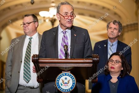 Senate Minority Leader Chuck Schumer (D-NY) makes a statement following the Democratic Party luncheon on Capitol Hill in Washington, DC, USA, 13 November 2019. Democrats were defending the impeachment proceedings in the House of Representatives and criticized the Trump administration for denying an expansion of benefits for over 80,000 Vietnam War veterans who are suffering from injuries and illnesses that have been connected to the war. Sen. Schumer is flanked by (from left to right) Sen. Jon Tester (D-MT), Sen. Sherrod Brown (D-OH), and Sen. Tammy Duckworth (D-IL).