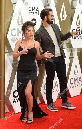 Jessie James Decker, left, and Eric Decker arrive at the 53rd annual CMA Awards at Bridgestone Arena, in Nashville, Tenn
