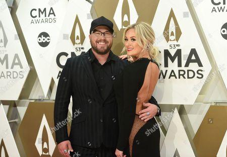 Mitchell Tenpenny, left, arrives at the 53rd annual CMA Awards at Bridgestone Arena, in Nashville, Tenn