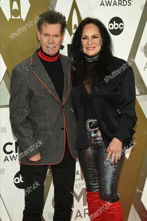Randy Travis, Mary Davis. Randy Travis, left, and Mary Davis arrive at the 53rd annual CMA Awards at Bridgestone Arena, in Nashville, Tenn