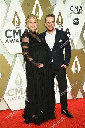 Jordan Reynolds, right, arrives at the 53rd annual CMA Awards at Bridgestone Arena, in Nashville, Tenn