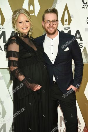 Stock Picture of Jordan Reynolds, right, arrives at the 53rd annual CMA Awards at Bridgestone Arena, in Nashville, Tenn
