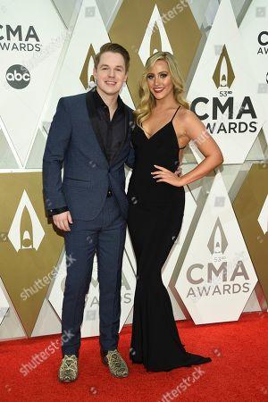 Stock Photo of Travis Denning, left, arrives at the 53rd annual CMA Awards at Bridgestone Arena, in Nashville, Tenn
