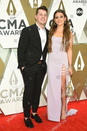 Josh Kerr, Taylor Dye. Josh Kerr, left, and Taylor Dye arrive at the 53rd annual CMA Awards at Bridgestone Arena, in Nashville, Tenn