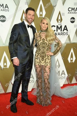 Mike Fisher, Carrie Underwood. Mike Fisher, left, and Carrie Underwood arrive at the 53rd annual CMA Awards at Bridgestone Arena, in Nashville, Tenn