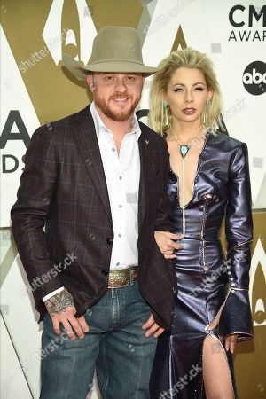 Cody Johnson, Brandi Johnson. Cody Johnson, left, and Brandi Johnson arrive at the 53rd annual CMA Awards at Bridgestone Arena, in Nashville, Tenn