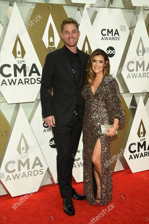 Brett Young, Taylor Mills. Brett Young, left, and Taylor Mills arrive at the 53rd annual CMA Awards at Bridgestone Arena, in Nashville, Tenn