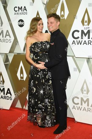 Stock Picture of Christina Murphy, Frankie Ballard. Christina Murphy, left, and Frankie Ballard arrive at the 53rd annual CMA Awards at Bridgestone Arena, in Nashville, Tenn