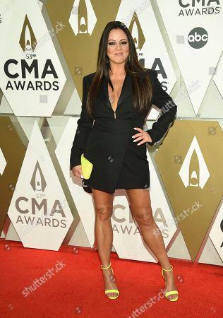 Sara Evans arrives at the 53rd annual CMA Awards at Bridgestone Arena, in Nashville, Tenn