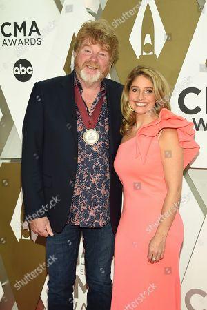 Mac McAnally, left, arrives at the 53rd annual CMA Awards at Bridgestone Arena, in Nashville, Tenn