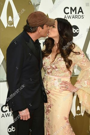 Stock Image of Rodney Atkins, Rose Falcon. Rodney Atkins, left, and Rose Falcon arrive at the 53rd annual CMA Awards at Bridgestone Arena, in Nashville, Tenn
