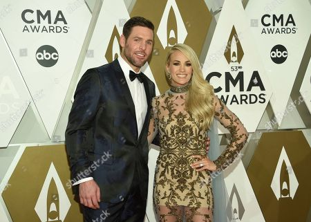 Stock Photo of Mike Fisher, Carrie Underwood. Mike Fisher, left, and Carrie Underwood arrive at the 53rd annual CMA Awards at Bridgestone Arena, in Nashville, Tenn