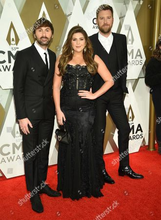 Dave Haywood, Hillary Scott, Charles Kelley. Dave Haywood, from left, Hillary Scott, and Charles Kelley of Lady Antebellum arrive at the 53rd annual CMA Awards at Bridgestone Arena, in Nashville, Tenn