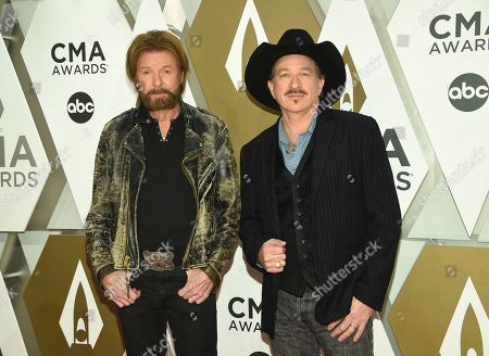 Ronnie Dunn, Kix Brooks. Ronnie Dunn, left, and Kix Brooks of Brooks & Dunn arrive at the 53rd annual CMA Awards at Bridgestone Arena, in Nashville, Tenn