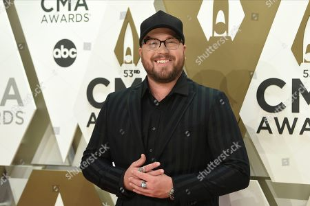 Mitchell Tenpenny arrives at the 53rd annual CMA Awards at Bridgestone Arena, in Nashville, Tenn