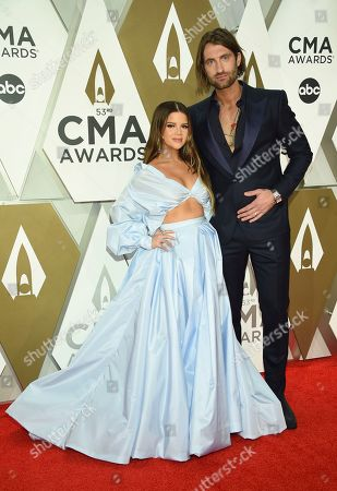 Maren Morris, left, and Ryan Hurd arrive at the 53rd annual CMA Awards at Bridgestone Arena, in Nashville, Tenn