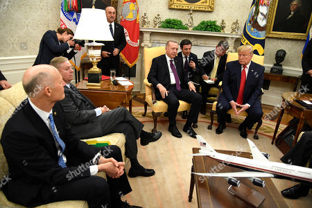 US President Donald Trump (R) listens to remarks by Turkish President Recep Tayyip Erdogan (4-R), during a meeting with Republican senators, including Sen. Rick Scott of Florida (L) and Sen. Lindsey Graham of South Carolina (2-L), in the Oval Office of the White House in Washington, DC, USA, 13 November 2019. The visit comes one month after Turkey's invasion into northern Syria against the Kurds and on the first day of public impeachment hearings.