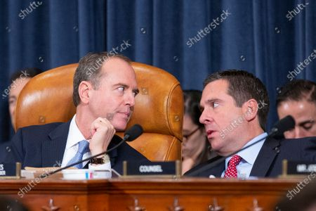 United States Representative Adam Schiff (Democrat of California) looks at United States Representative Devin Nunes (Republican of California) during the testimony of Deputy Assistant U.S. Secretary of State George Kent and Acting U.S. Ambassador to Ukraine William Taylor before the U.S. House Permanent Select Committee on Intelligence