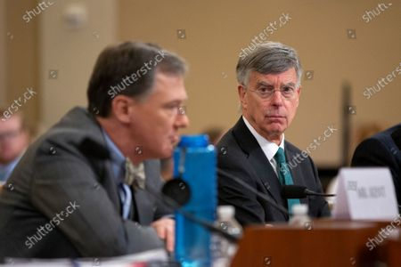 Acting U.S. Ambassador to Ukraine William Taylor listens to Deputy Assistant U.S. Secretary of State George Kent testify before the U.S. House Permanent Select Committee on Intelligence