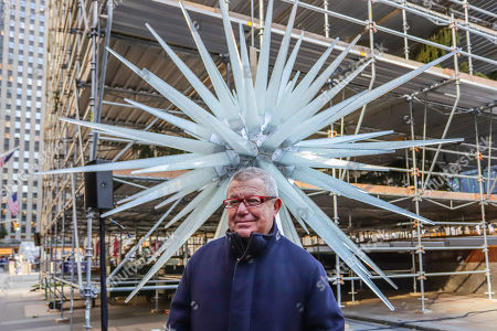 Architect Daniel Libeskind with the 900-pound Swarovski crystal star which was lifted by a crane and attached to the Rockefeller Center Christmas tree.