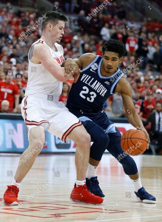 Villanova's Jermaine Samuels, right, drives to the basket as Ohio State's Kyle Young defends during the first half of an NCAA college basketball game, in Columbus, Ohio