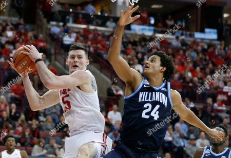 Ohio State's Kyle Young, left, grabs a rebound away from Villanova's Jeremiah Robinson-Earl during the second half of an NCAA college basketball game, in Columbus, Ohio. Ohio State won 76-51