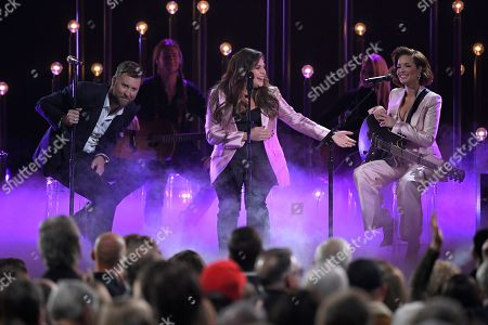 """Charles Kelley, Hillary Scott, Halsey. Charles Kelley, left, and Hillary Scott, center of Lady Antebellum perform """"What if I Never Get Over You"""" and """"Graveyard"""" with Halsey, at the 53rd annual CMA Awards at Bridgestone Arena, in Nashville, Tenn"""