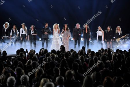 "Jennifer Wayne, from left, Naomi Cooke and Hannah Mulholland of Runaway June, Ashley McBryde, Jimi Westbrook, Kimberly Schlapman, Karen Fairchild, Phillip Sweet of Little Big Town, Carly Pearce, Madison Marlow and Taylor Dye of Maddie & Tae and Lindsay Ell perform ""Girl Crush"" at the 53rd annual CMA Awards at Bridgestone Arena, in Nashville, Tenn"