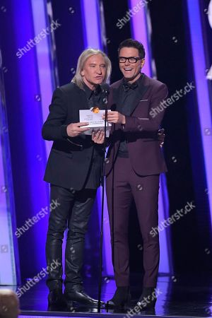 Joe Walsh, Bobby Bones. Joe Walsh, left, and Bobby Bones present the award for album of the year at the 53rd annual CMA Awards at Bridgestone Arena, in Nashville, Tenn