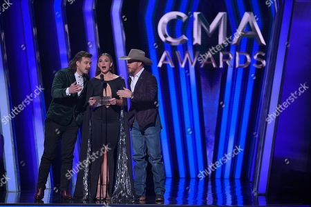 Stock Image of Morgan Wallen, Hannah Brown, Cody Johnson. Morgan Wallen, from left, Hannah Brown, and Cody Johnson present the award for vocal group of the year at the 53rd annual CMA Awards at Bridgestone Arena, in Nashville, Tenn