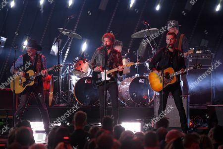 "Kix Brooks, Ronnie Dunn, T.J. Osborne. Kix Brooks, left, and Ronnie Dunn, center, of Brooks & Dunn perform ""Hard Workin' Man"" with T.J. Osborne of Brothers Osborne at the 53rd annual CMA Awards at Bridgestone Arena, in Nashville, Tenn"