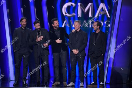 Geoff Sprung, Matthew Ramsey, Brad Tursi, Trevor Rosen, Whit Sellers. Geoff Sprung, from left, Matthew Ramsey, Brad Tursi, Trevor Rosen and Whit Sellers of Old Dominion accept the award for vocal group of the year at the 53rd annual CMA Awards at Bridgestone Arena, in Nashville, Tenn