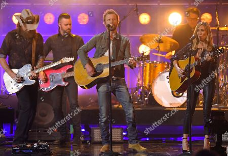 "John Osborne, Dierks Bentley, Sheryl Crow. John Osborne of Brothers Osborne, from left, Dierks Bentley and Sheryl Crow perform ""Me and Bobby McGee"" at the 53rd annual CMA Awards at Bridgestone Arena, in Nashville, Tenn"