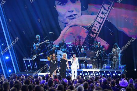 """Stock Photo of Gretchen Wilson, Kimberly Schlapman, Jennifer Nettles. Gretchen Wilson, from left, Kimberly Schlapman, and Jennifer Nettles perform """"You're Lookin' at Country"""" at the 53rd annual CMA Awards at Bridgestone Arena, in Nashville, Tenn"""