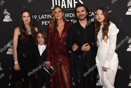 Juanes, Karen Martinez, Luna Aristizabal, Dante Aristizabal, Paloma Aristizabal. Juanes, from second right, Karen Martinez, and their children, from left, Paloma Aristizabal, Dante Aristizabal and Luna Aristizabal arrive at the Latin Recording Academy Person of the Year gala in his honor at the MGM Conference Center, in Las Vegas