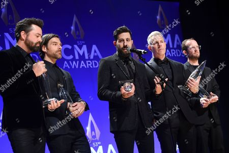 Stock Photo of Brad Tursi, Geoff Sprung, Matthew Ramsey, Trevor Rosen, Whit Sellers. Old Dominion band members, from left, Brad Tursi, Geoff Sprung, Matthew Ramsey, Trevor Rosen and Whit Sellers speak in the press room with the vocal group of the year award at the 53rd annual CMA Awards at Bridgestone Arena, in Nashville, Tenn