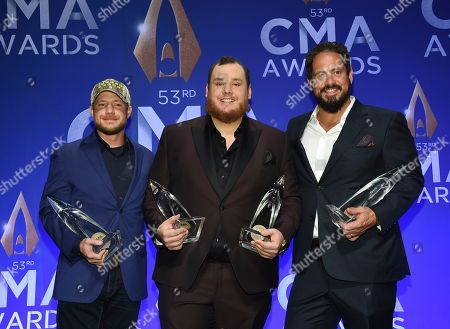 Stock Photo of Robert Williford, Luke Combs, Wyatt Durrette. Singer-songwriter Luke Combs, center, poses with songwriters Robert Williford, left, and Wyatt Durrette with the awards for male vocalist of the year and song of the year at the 53rd annual CMA Awards at Bridgestone Arena, in Nashville, Tenn