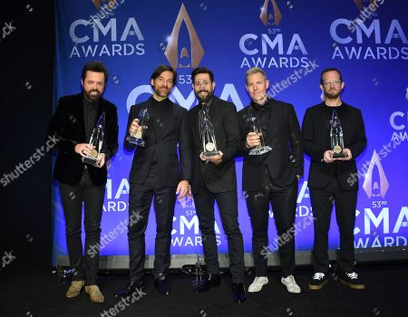 Brad Tursi, Geoff Sprung, Matthew Ramsey, Trevor Rosen, Whit Sellers. Old Dominion band members, from left, Brad Tursi, Geoff Sprung, Matthew Ramsey, Trevor Rosen and Whit Sellers pose in the press room with the vocal group of the year award at the 53rd annual CMA Awards at Bridgestone Arena, in Nashville, Tenn