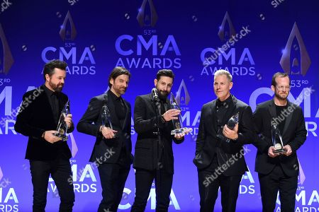 Stock Picture of Brad Tursi, Geoff Sprung, Matthew Ramsey, Trevor Rosen, Whit Sellers. Old Dominion band members, from left, Brad Tursi, Geoff Sprung, Matthew Ramsey, Trevor Rosen and Whit Sellers pose in the press room with the vocal group of the year award at the 53rd annual CMA Awards at Bridgestone Arena, in Nashville, Tenn