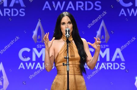 Stock Photo of Kasey Musgraves speaks in the press room after winning awards for female vocalist of the year and music video of the year at the 53rd annual CMA Awards at Bridgestone Arena, in Nashville, Tenn