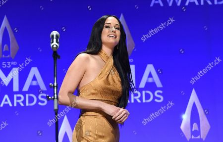 Stock Image of Kasey Musgraves poses in the press room after winning awards for female vocalist of the year and music video of the year at the 53rd annual CMA Awards at Bridgestone Arena, in Nashville, Tenn