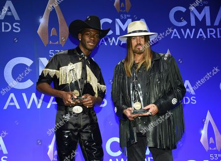 Lil Nas X, Billy Ray Cyrus. Musicians Lil Nas X, left, and Billy Ray Cyrus speak in the press room after winning the musical event of the year award at the 53rd annual CMA Awards at Bridgestone Arena, in Nashville, Tenn