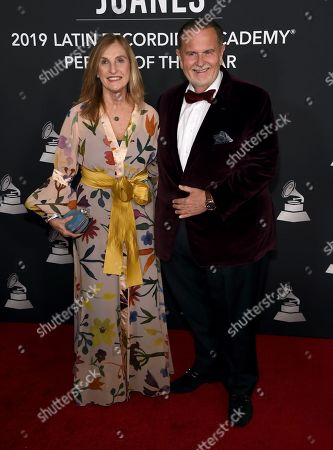 Raul De Molina, Millie de Molina. Raul De Molina, left, and Millie de Molina arrive at the Latin Recording Academy Person of the Year gala honoring Juanes at the MGM Conference Center, in Las Vegas